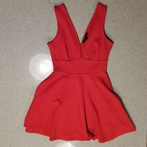 Red cocktail dress with back cutout.
